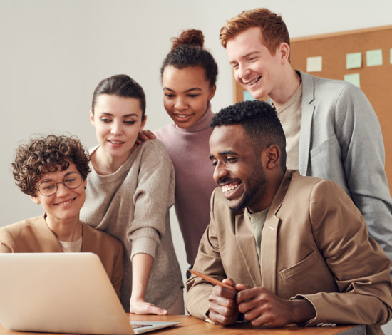 Group of young multi-ethnic HR Solutions people looking at a computer screen